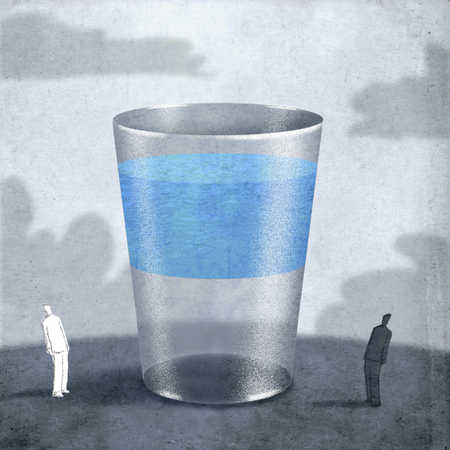 Two people looking at water in glass