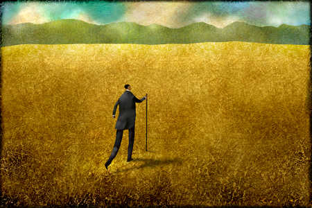 Businessman walking through remote rural field