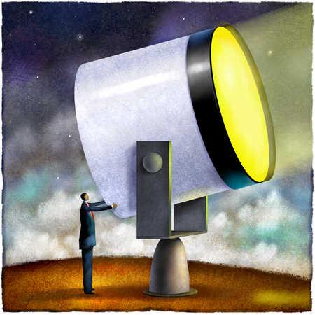 Businessman adjusting large spotlight