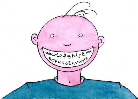 Smiling boy showing alphabet in mouth