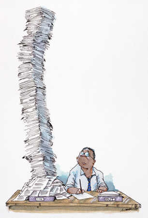 Man with large pile of paperwork