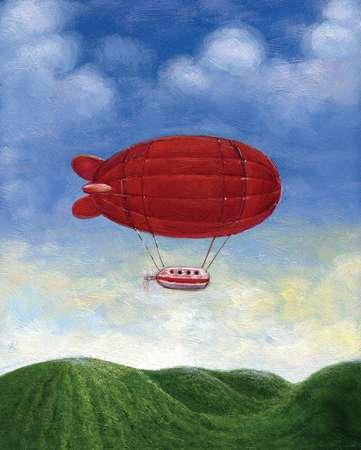 A red blimp floating over green hills