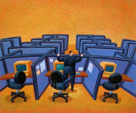 Executive Looking At Empty Cubicles
