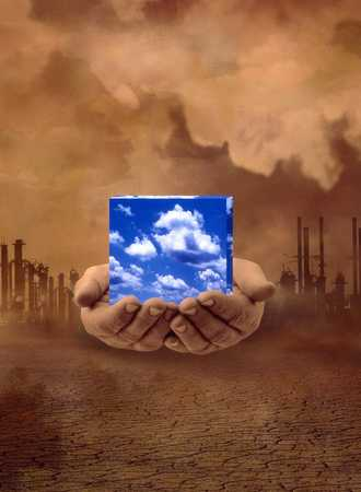 Hands Holding Sky Cube In Factory Landscape
