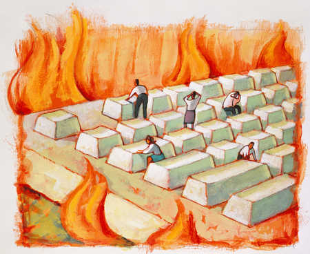 Business people standing on computer keyboard surrounded by fire