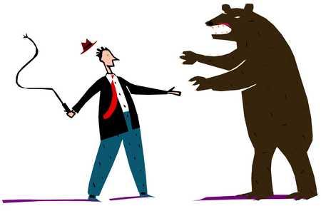 Man taming a bear