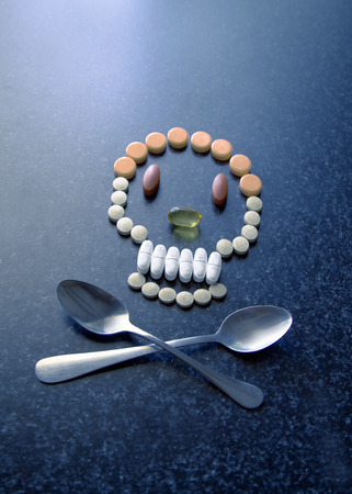 Pills and spoons as skull and crossbones