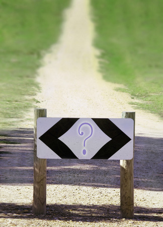 2 way question mark sign with walk path