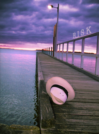 pier at night with risk text