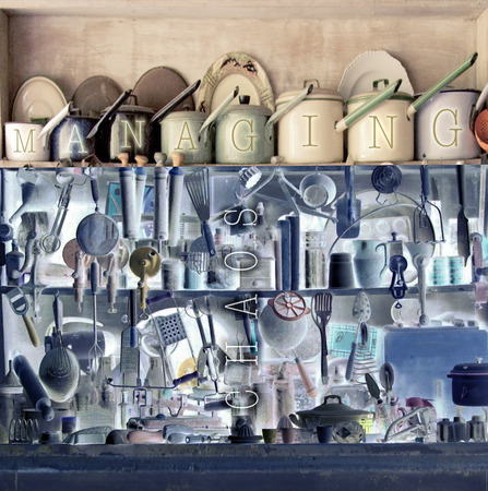 Saucepans on kitchen shelves in order & chaos
