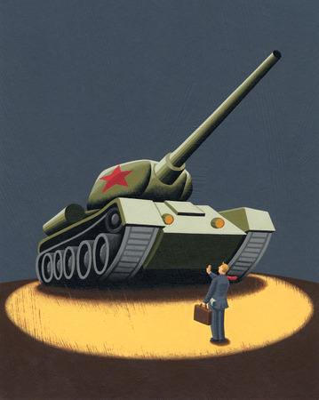 Businessman stopping military tank