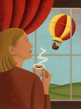Woman looking at hot air balloon from window