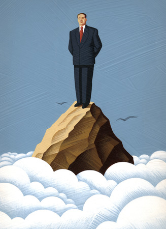 Businessman standing on mountain top