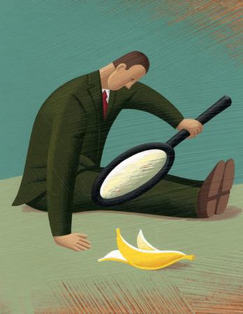 Businessman examining banana peel