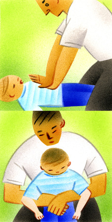 Man performing first aid on boy