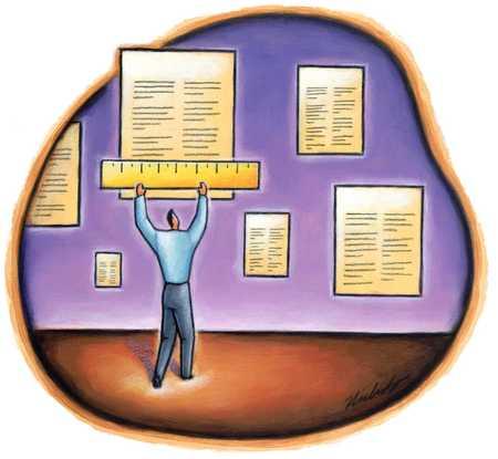 Man Measuring Documents
