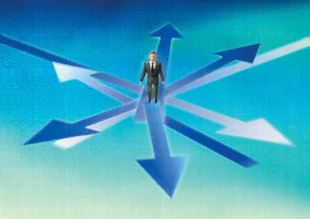 Businessman at crossroads