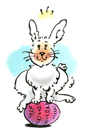 Rabbit hopping over egg