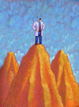 Man in lab coat standing on top of cliff with hands on hips