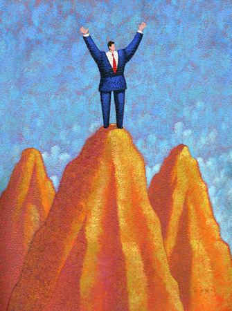 Businessman standing on top of cliff with arms raised