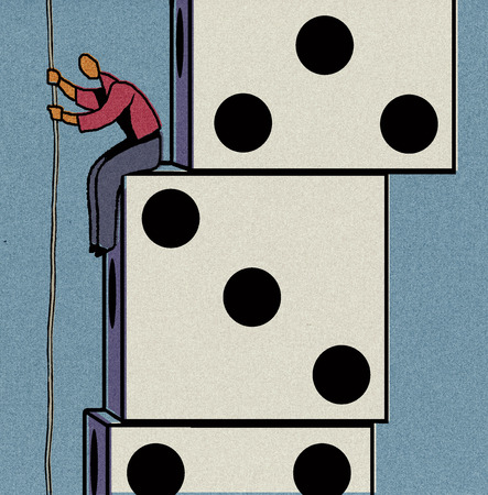 Man sitting on dice holding rope