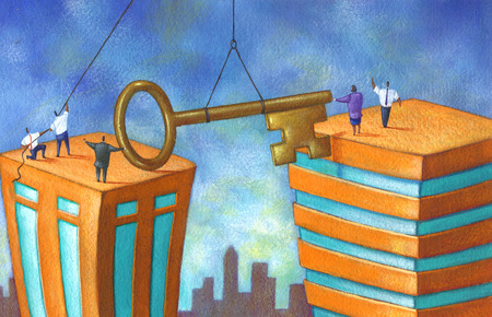 Business people bridging gap between buildings with large key