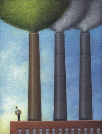 Man standing below smokestacks