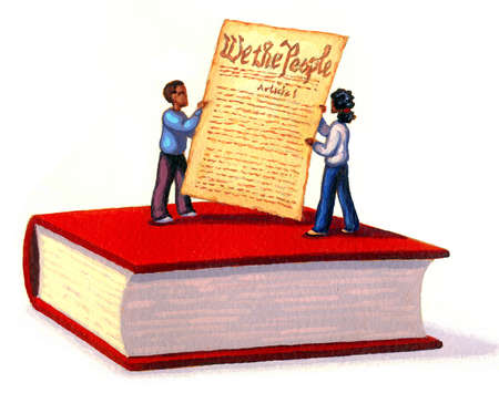 Children holding the US Constitution and standing on book