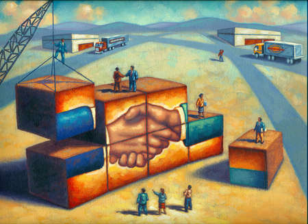 Business people assembling building with image of shaking hands