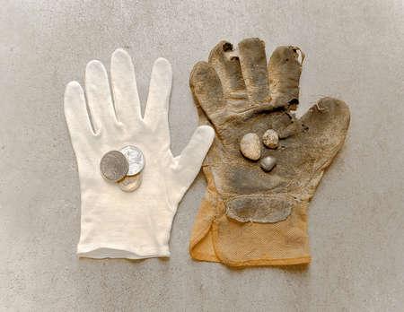 white glove holding money and work glove holding rocks