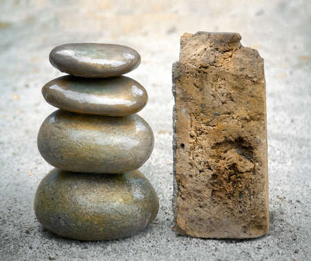 stack of smooth stones next to rough one