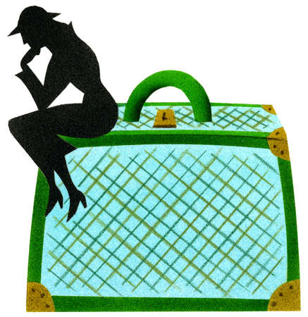 Silhouette of woman sitting on suitcase