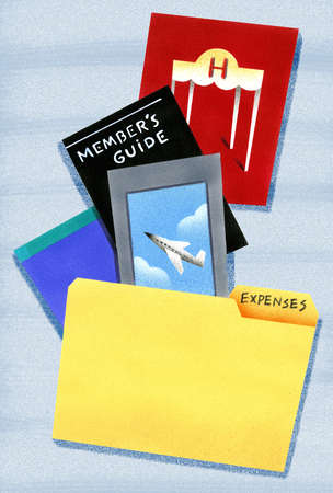 Travel and tourism brochures near 'Expenses' folder