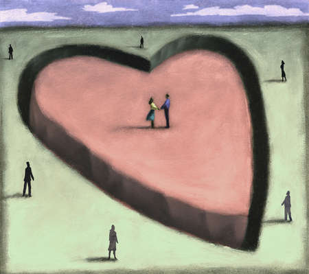 Couple standing on isolated heart
