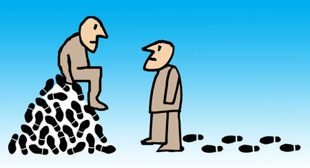 Man sitting on hill of footprints