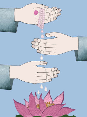 Hands holding pearls over flower