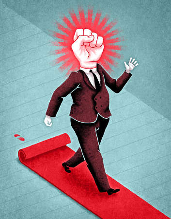 Businessman with raised fist for head walking on red carpet