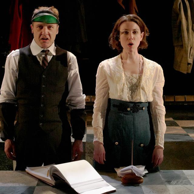 """Brendan McNab and Liz Hayes sing about the stresses of life in SpeakEasy Stage Company's """"Adding Machine,"""" which runs through April 10."""