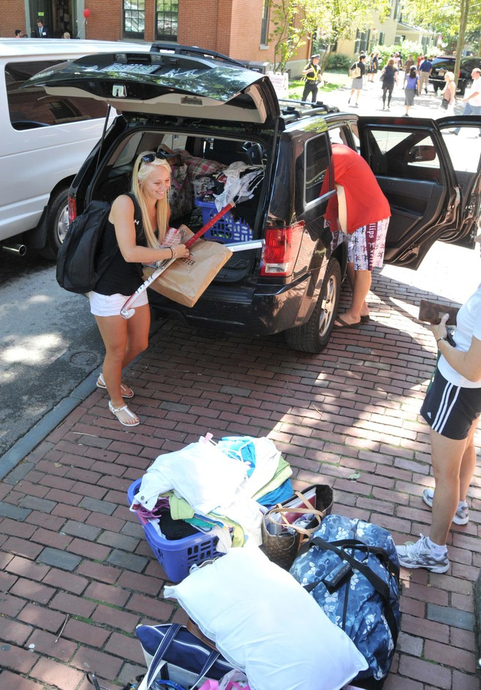 Freshmen, their parents, and their belongings filled the Yard last week as the Class of 2014 arrived on campus and moved in to the dorms in Harvard Yard.