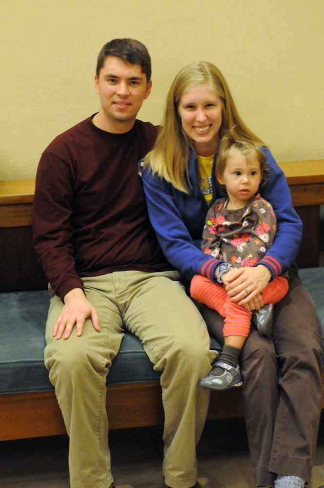 The McGinnisses are both undergraduates, he at Harvard and she at Wellesley. The couple takes a break from studying for final exams to play with their two year old daughter, Sophie.