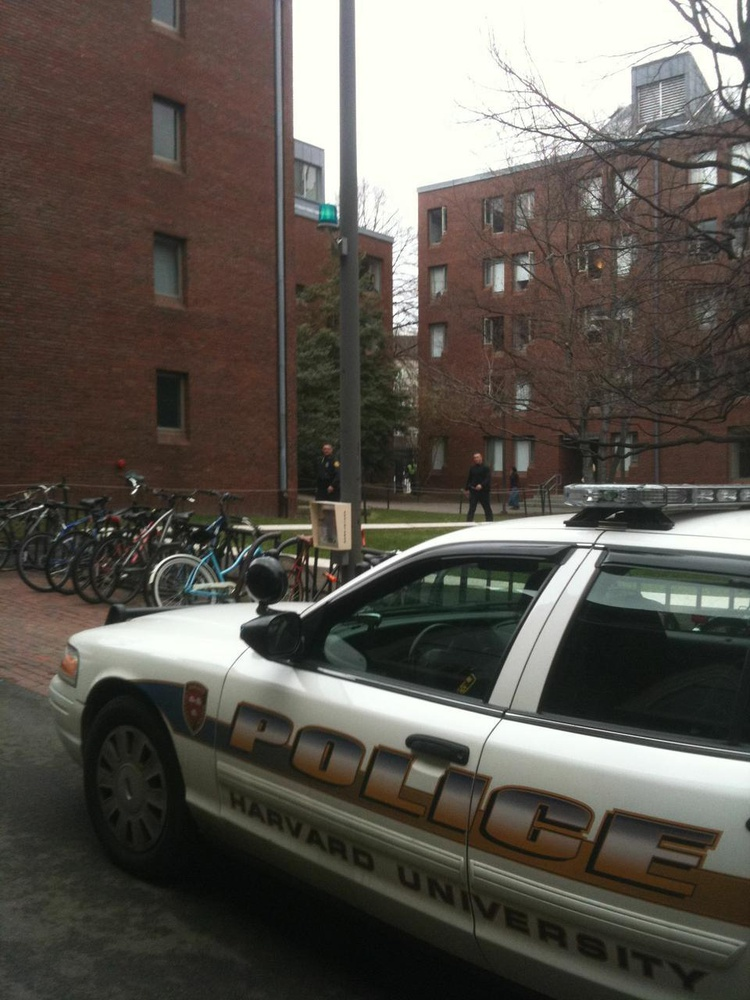 Police converged on Canaday Hall after a foot chase through Harvard Yard which resulted in the apprehension of two men suspected of stealing two cellphones from the T-Mobile store in Harvard Square around noon yesterday.