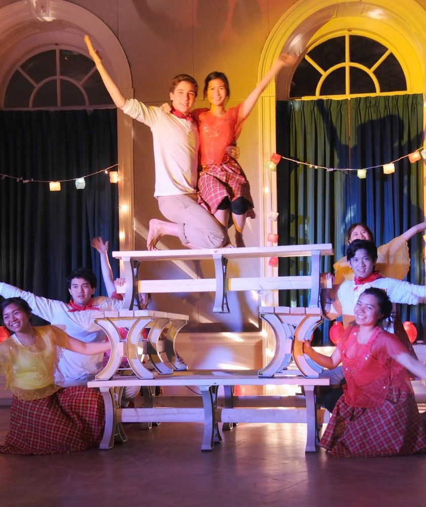 Student members of HPF (Harvard Philippine Forum) dance on top of benches for the Sayaw sa Bangko, a folk dance that originated from the Pangasinan province of the Philippines.