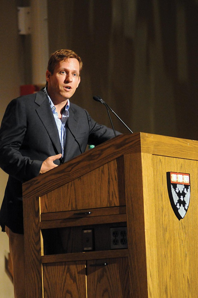 Peter A. Thiel, the co-founder of PayPal and first outside investor in Facebook, questions how entrepreneurs and business ought to divide their focus between globalization and pushing technology and innovation at the Business School yesterday. His talk was hosted by the Harvard innovation lab.