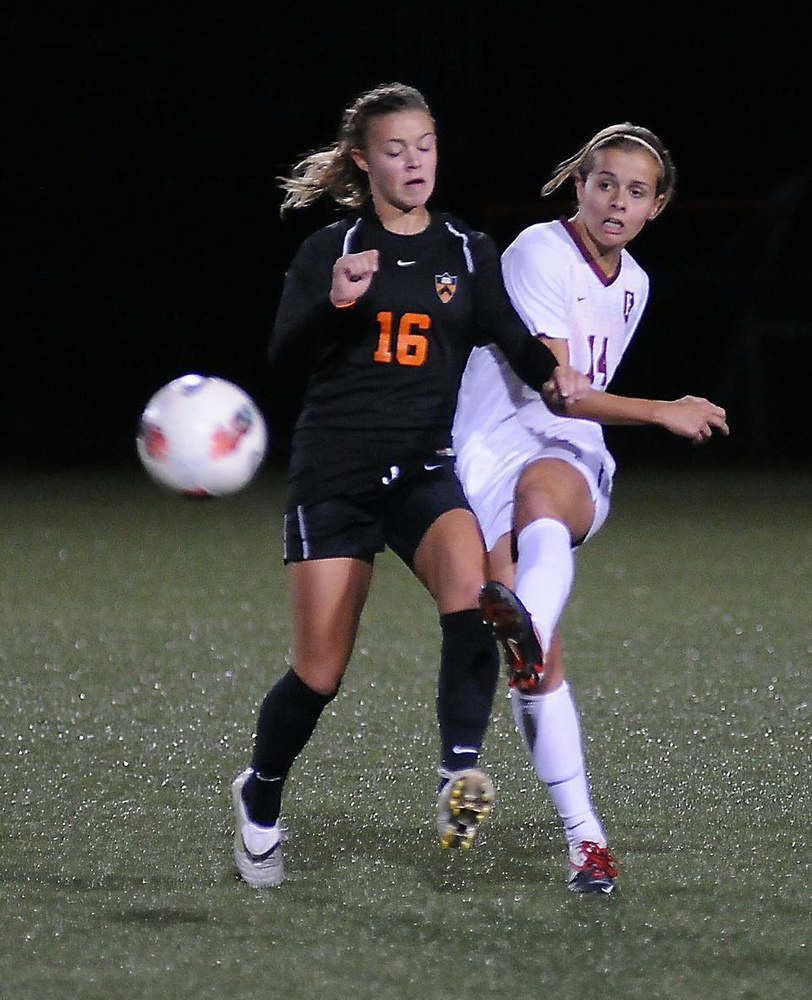 In her first game as co-captain, junior Peyton Johnson, shown above in earlier action, notched a goal and an assist in the Harvard women's soccer team's 2-0 win against UMass on Friday.