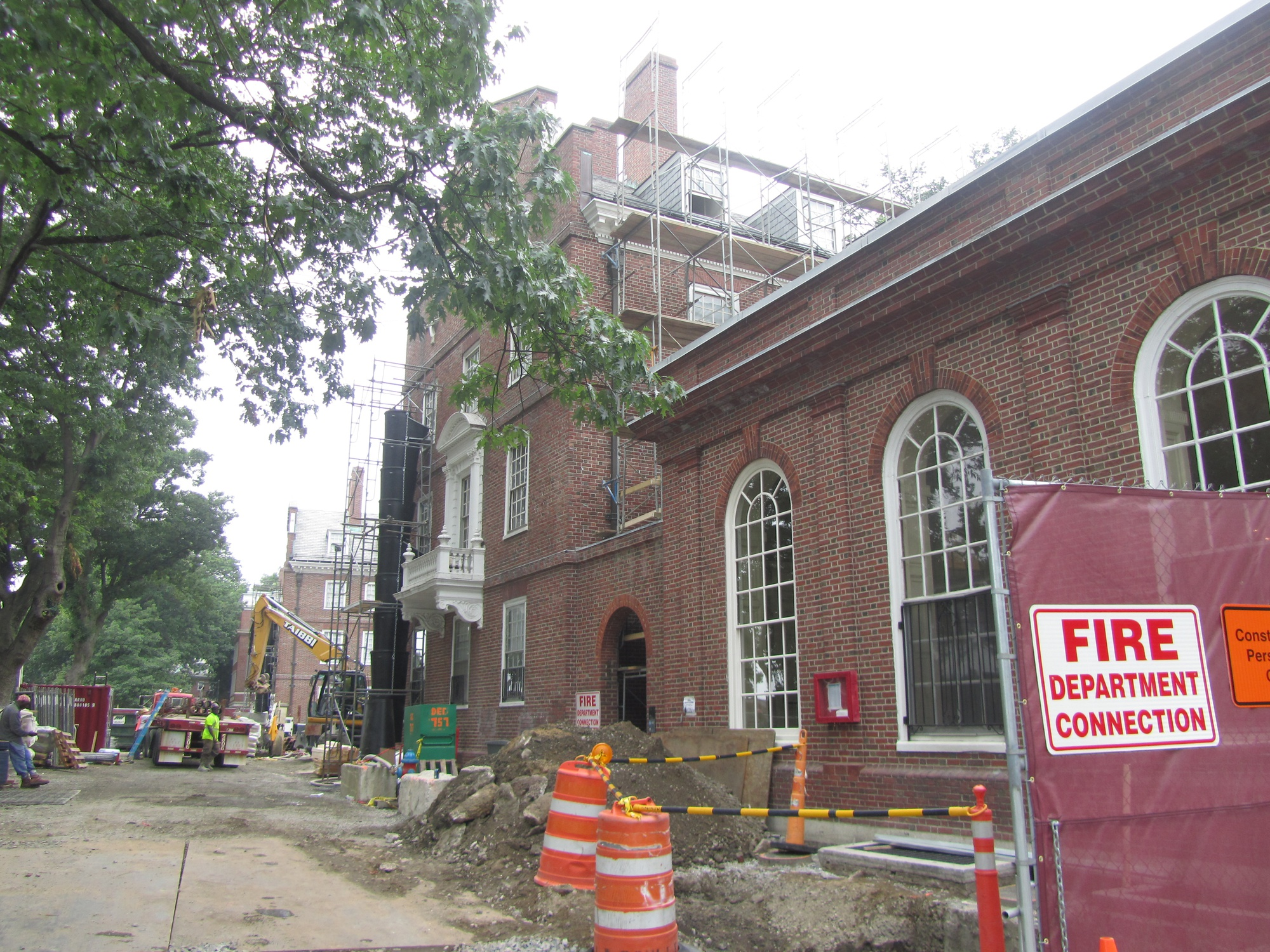 Old Leverett House stands amid construction on June 27. The renovation of McKinlock Hall has been underway since immediately after Commencement, according to Faculty of Arts and Sciences spokesperson Colin Manning.
