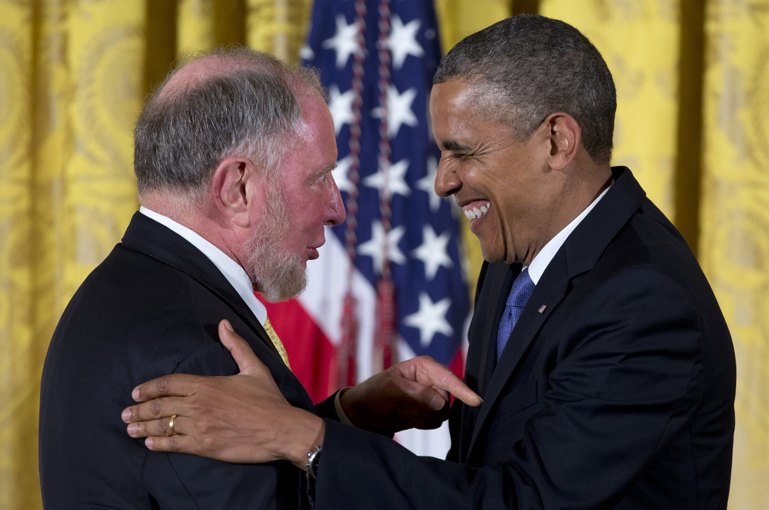 President Barack Obama laughs with Robert Putnam as he awards him the the 2012 National Humanities Medal during a ceremony in the East Room of White House on Wednesday.