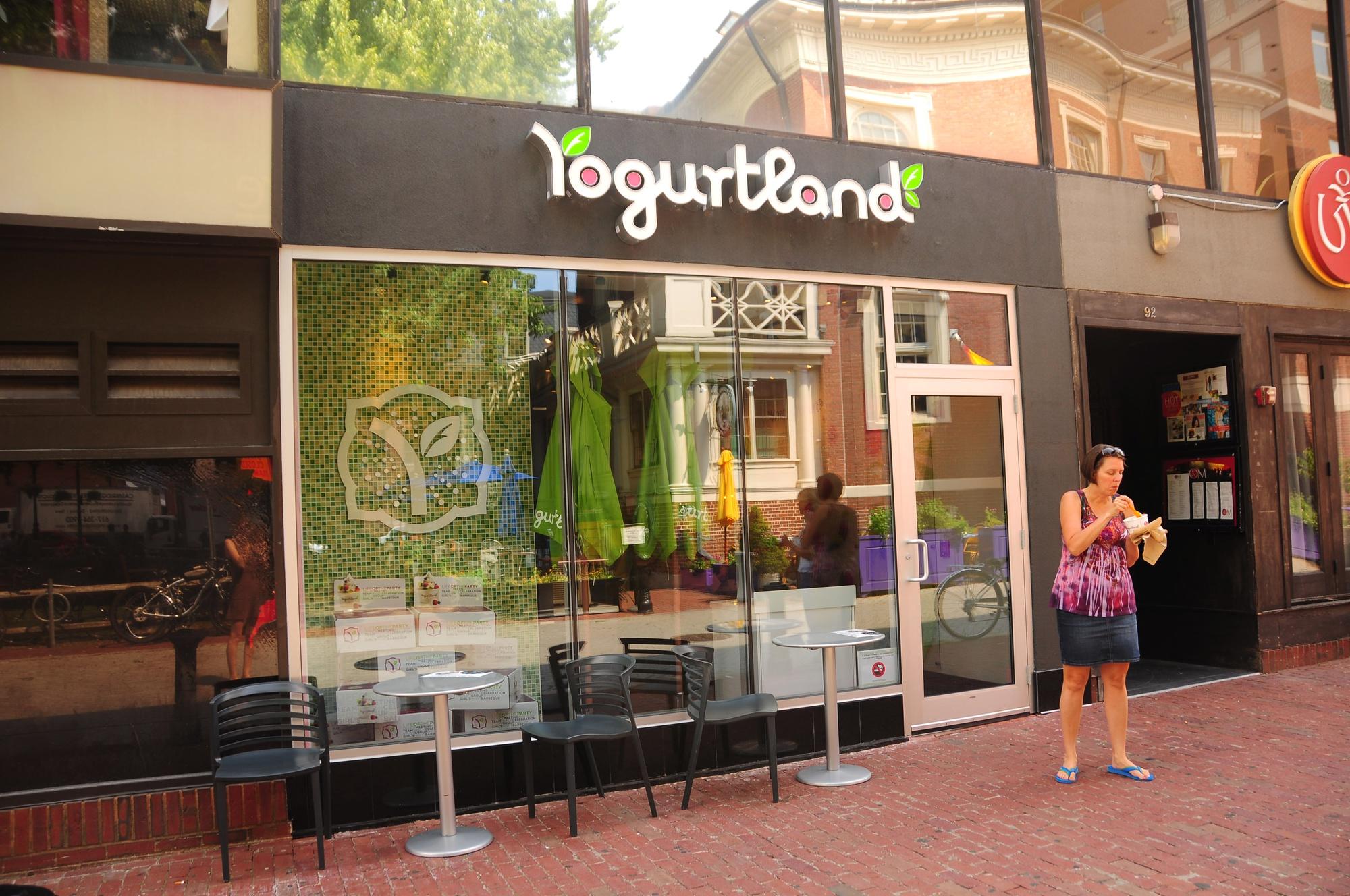 Yogurtland patron Debbie Marujo exits the new frozen yogurt joint, chocolate and pistachio froyo in hand.
