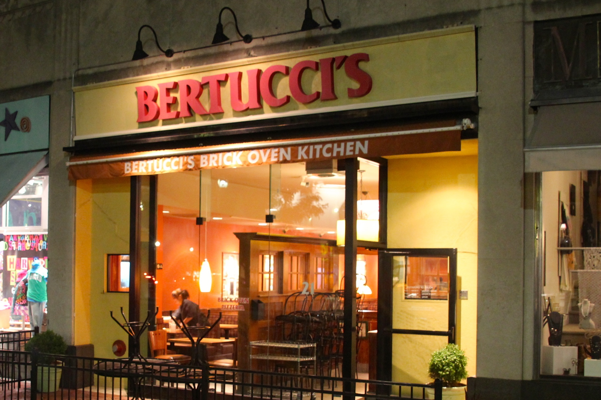 Bertucci's in Harvard Square still has its lights on Wednesday night as the last customers finish their meals. The Italian restaurant closed its doors for the final time on Wednesday.