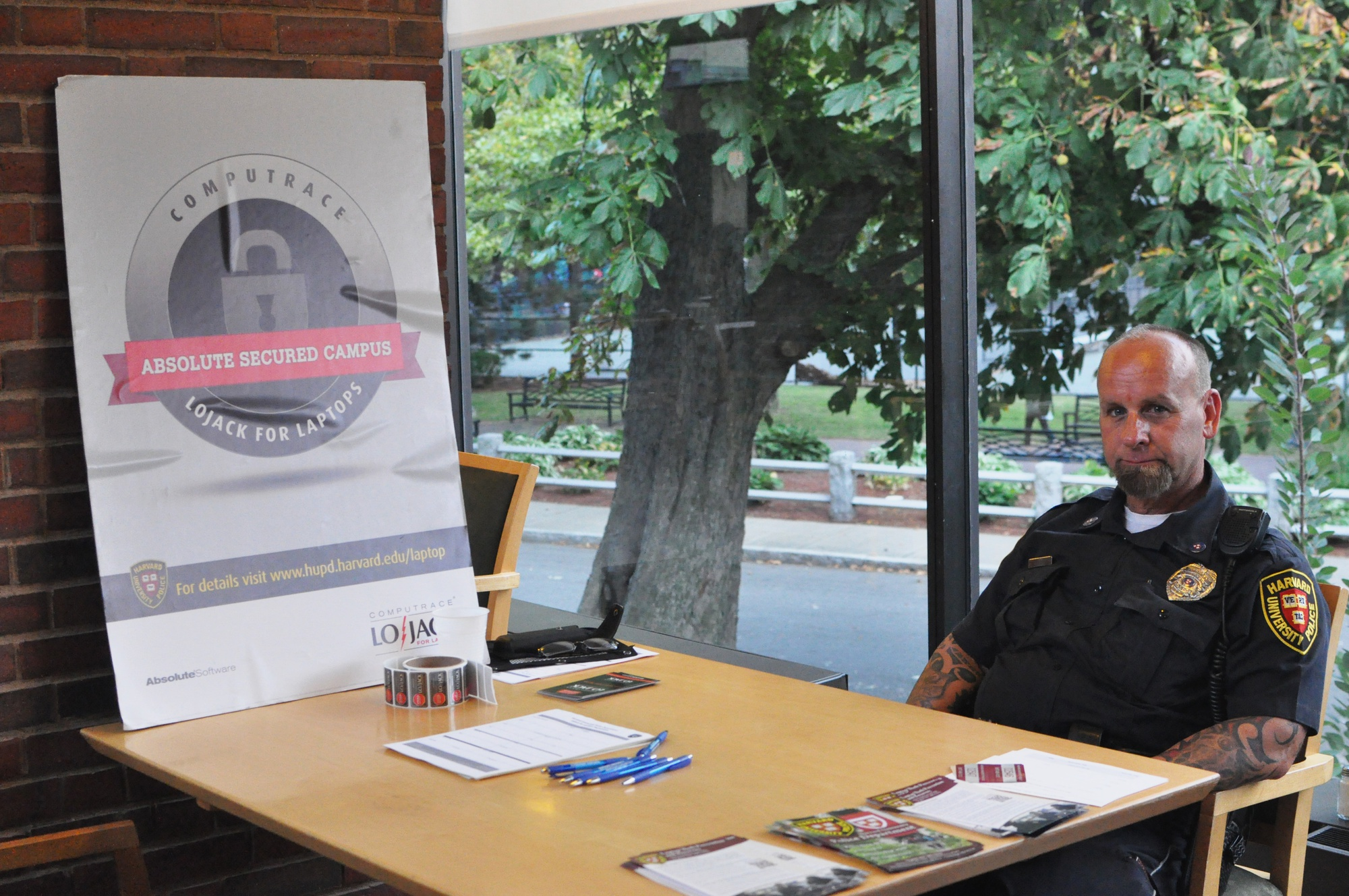 Officer Wayne F. Gabaree awaits for students in need of registration for their laptops in Mather dining hall Thursday afternoon.