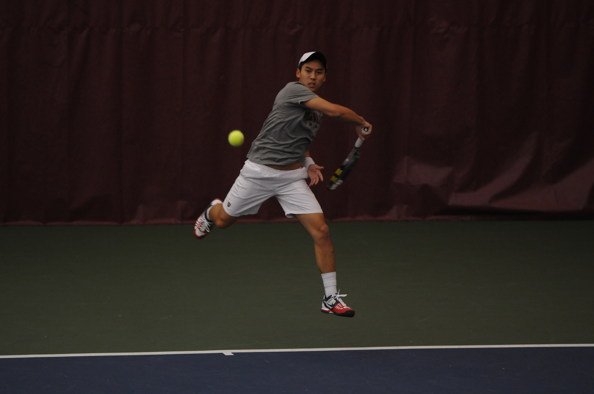 Junior Denis Nguyen and the Harvard men's tennis team, shown here in previous action, fell to Oklahoma in the second round of the NCAA Tournament.